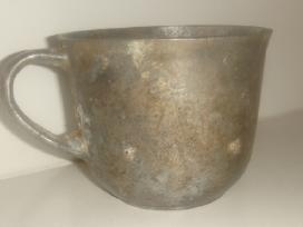 Karo laikų puodelis