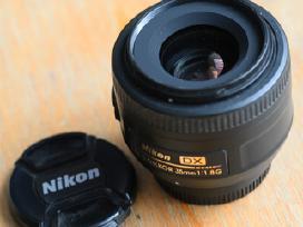 Perku Nikon ir Canon veidrodinius fotoaparatus,