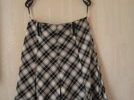 Langeliais margintas sijonas