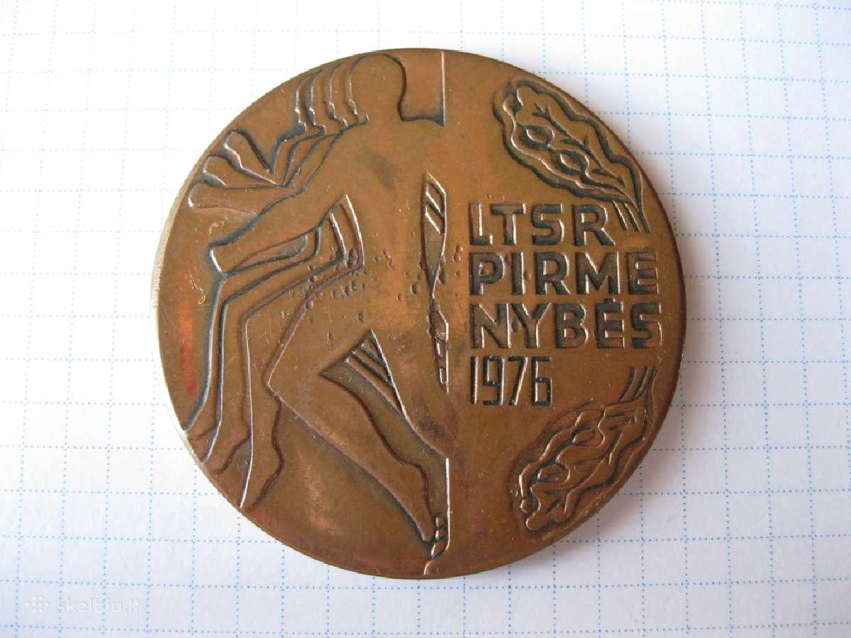 Stalo medalis.zr. foto.spalvotas metalas