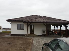 Karkasiniu, bei mūrinių namų statyba