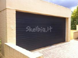 Pakeliami segmentiniai garažo vartai