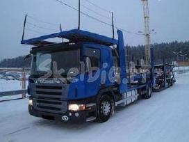 Vezame automobilius is anglijos i Lietuva. GB-lt