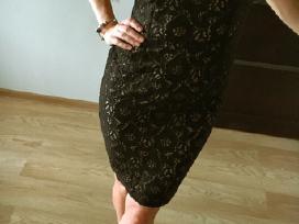Elegantiška nėrinių suknelė