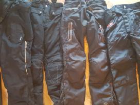Įvairių firmų tekstilinės moto kelnės, džinsai