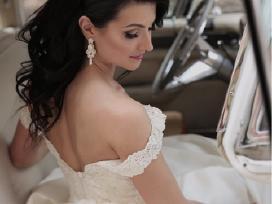 Romantisko stiliaus vestuvine suknele