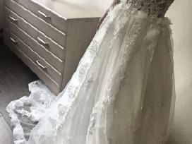 Ivory neriniuota vestuvine suknele