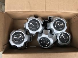 Mazda lietu ratlankiu gaubtai