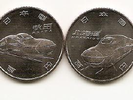 Japonijos 100 yen monetos su traukiniais