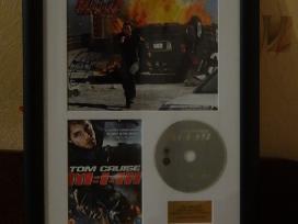 Tomo Kruzo nuotrauka su autografų