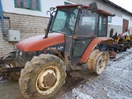 Traktorius New Holland L85 ardomas dalimis