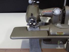 Paslepto dygsnio siuvimo masina