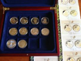 """""""Monetu Namai""""-kolekcijos monetai-medaliu."""