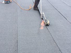 Stogdengiai- sutapdintų (plokščių) stogų dengimas