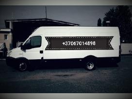 Krovinių pervežimas ir perkraustymo paslaugos.