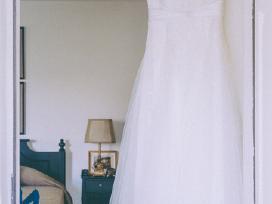 Laiminga klasikinė vestuvinė suknelė